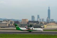 UNI Air ATR ATR-72-600 landing. TAIPEI, TAIWAN - MAY 18, 2019: UNI Air ATR ATR-72-600 landing to the Taipei Songshan Airport in Taipei, Taiwan stock image