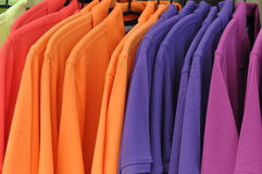 Uni colored pique-shirts. Uni colored pique- shirts on hangers - casual wear Royalty Free Stock Photography