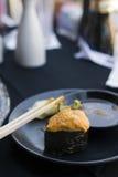 Uni Nigiri Sushi. Last Uni  Nigiri Sushi on diners plate in Japanese Sushi  restaurant Royalty Free Stock Photos
