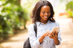 Uni student cell phone. Happy young african american uni student using cell phone Royalty Free Stock Photo