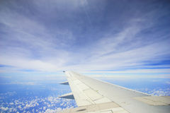 Unic cloud formation with blue sky, view from flight windows with copyspace area Stock Photos
