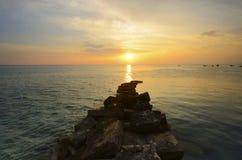 Unic formation rock lead to sunset on mabul island Stock Photos