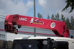 Unic V550 kran på den privata lastbilen Arkivfoto