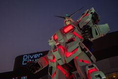 UNICON GUNDAM标度RX-0在Div的流动衣服雕象1:1模型  免版税库存照片