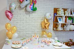 Unicorn party. Unicorn  balloon ,Kids birthday party decoration and cake. Decorated table for child birthday celebration. Rainbow unicorn cake Royalty Free Stock Photo