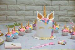 Unicorn party. Unicorn  balloon ,Kids birthday party decoration and cake. Decorated table for child birthday celebration. Rainbow unicorn cake Stock Image