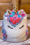 Unicorn birthday cake. For little girls decorated with colorful whipped cream and number nine on the top. Close up royalty free stock photos