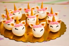 Unicorn cake and cupcakes for a party. Unicorn cupcakes ,Kids birthday party decoration and cake. Decorated table for child birthday celebration. Rainbow unicorn royalty free stock image