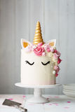 Unicorn cake. On a cake stand royalty free stock image