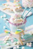 Unicorn hot chokolate and cookies. Unicorn cookies on a wooden background stock photography