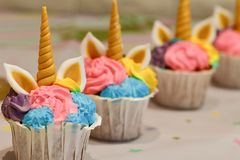 Unicorn cupcakes  for a party. Unicorn cupcakes ,Kids birthday party decoration and cake. Decorated table for child birthday celebration. Rainbow unicorn cake Royalty Free Stock Photos