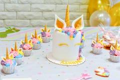 Unicorn   decoration  for  party. Unicorn  balloon ,Kids birthday party decoration and cake. Decorated table for child birthday celebration. Rainbow unicorn cake Royalty Free Stock Image