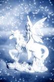 Unicorn with elf fairy. Winter dreamy scene with white unicorn with elf fairy over blue background and snow flakes Stock Photo