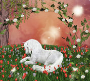 Unicorn in an enchanted meadow Stock Images