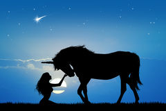 Unicorn and girl Royalty Free Stock Photography