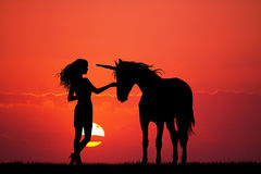 Unicorn and girl Stock Images