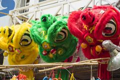 Unicorn heads for sale on Hang Ma street. The toy used to perform dragon and lion dance in oriental traditional festivals Royalty Free Stock Images