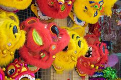 Unicorn heads for sale on Hang Ma street. The toy used to perform dragon and lion dance in oriental traditional festivals Royalty Free Stock Photography
