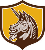 Unicorn Horse Head Side Crest Retro. Illustration of a unicorn horse head viewed from the side set inside shield crest on isolated background done in retro style Royalty Free Stock Photography