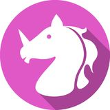 Unicorn icon. Head of a unicorn icon white silhouette on a pink background royalty free illustration