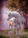 Unicorn Mare och föl Arkivfoto