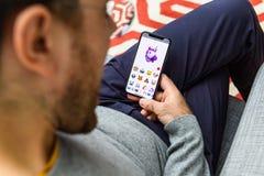 Unicorn memoji man faceid using latest iPhone Xs. LONDON, UK - SEP 21, 2018: Man using the new AR Memoji emoji on Apple iPhone Xs with the immense OLED retina Royalty Free Stock Photo