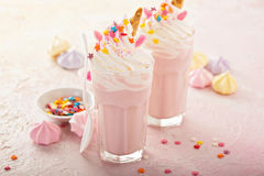 Unicorn milkshakes with sprinkles. Pink unicorn milkshakes with whipped cream, sugar and sprinkles Stock Image
