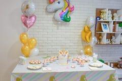 Unicorn party. Unicorn  balloon ,Kids birthday party decoration and cake. Decorated table for child birthday celebration. Rainbow unicorn cake Royalty Free Stock Photos
