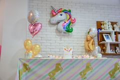 Unicorn party. Unicorn  balloon ,Kids birthday party decoration and cake. Decorated table for child birthday celebration. Rainbow unicorn cake Royalty Free Stock Images