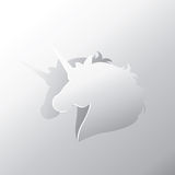 Unicorn peel off from silver paper background Stock Photo