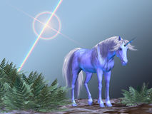 Unicorn Resting. A white unicorn rests under a bright star royalty free stock photo