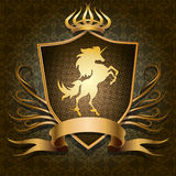 The unicorn shield. The shield with golden unicorn and banner for text against textured background with floral elements drawn in classic style royalty free illustration