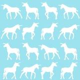 Unicorn silhouettes over blue background Stock Photo