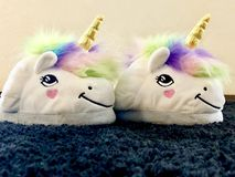 Unicorn slippers stock photos
