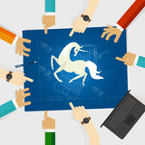 Unicorn start-up tech company hands pointing white horse around the blue print with sketch drawing Stock Photos