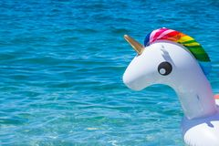 Free Unicorn Swim Tube On Water Background. Inflatable Unicorn.Fantasy Swim Ring For Summer Pool Or Sea. Active Funny Stock Photos - 115173243
