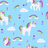 Unicorni sul modello senza cuciture blu fotografia stock libera da diritti