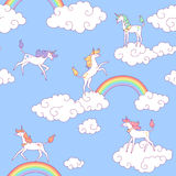 Unicorns and clouds. White unicorns and clouds in the  blue sky. Seamless pattern for your design Stock Photo