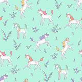 Unicorns on meadow. White unicorns on the green meadow. Seamless pattern for design and textile stock illustration