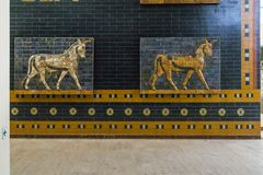 Unicorns in Museum of Archeology, Istanbul. ISTAMBUL, TURKEY - SEPTEMBER 13, 2017: These are fragments of the gate Ishtar from Babylon with the image of unicorns stock photography