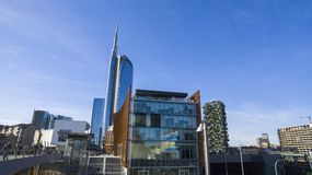 Unicredit tower and pedestrian bridge seen from Piazza Alvar Aalto, Milan, Italy. The tallest skyscraper in Italy. Vertical forest Stock Photo