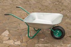 Unicycle construction wheelbarrow. Royalty Free Stock Photos