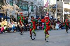 Unicyclers bij Parade Stock Afbeeldingen