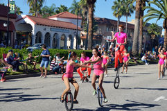 Unicycling and juggling. VENICE, FL - OCTOBER 18:  Unicyclers and a juggler perform as part of the the Annual Venice Sun Fiesta parade on October 18, 2014 in Royalty Free Stock Photo