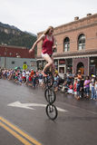 Unicyclist bicycles Stock Images