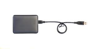 Unidad de disco duro portátil del externo HDD con el cable del USB en los vagos blancos Fotos de archivo libres de regalías