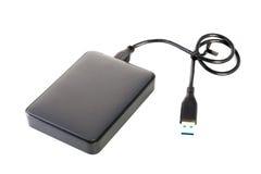 Unidad de disco duro portátil del externo HDD con el cable del USB en los vagos blancos Imágenes de archivo libres de regalías