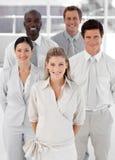 Unidade de negócio de cinco povos que olham a câmera Fotografia de Stock Royalty Free