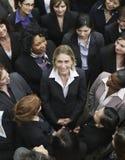 Unidade de negócio que olha a mulher no meio imagens de stock royalty free