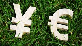 Unidade monetária da troca em um fundo da grama Foto de Stock Royalty Free